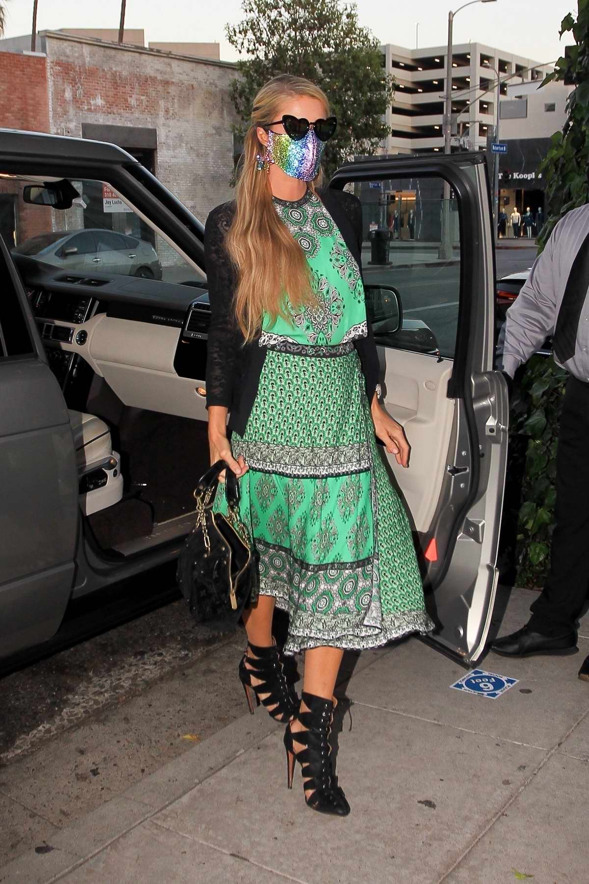 Paris Hilton seen wearing a colorful face mask as she arrives at The Ivy in Los Angeles