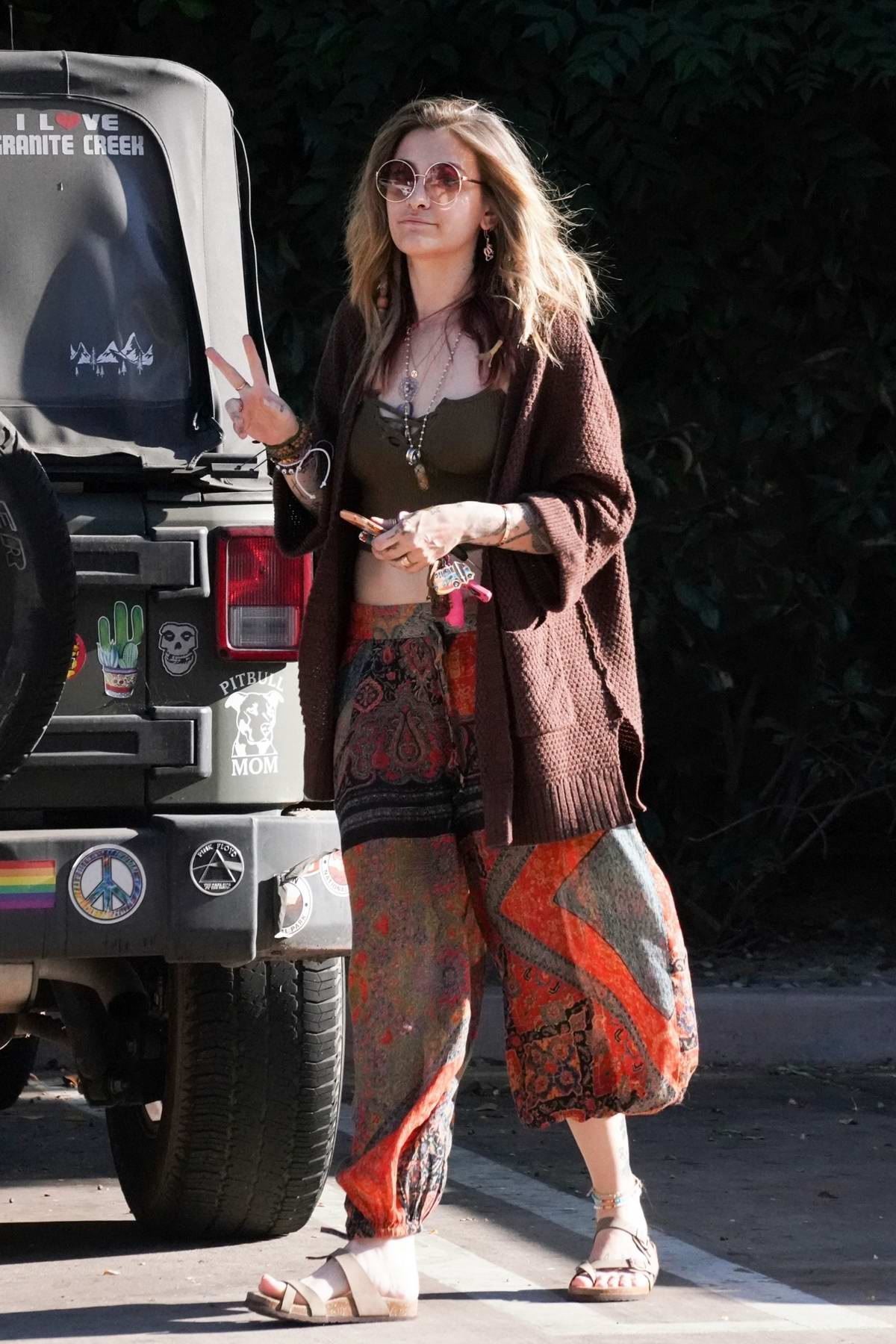 Paris Jackson flashes the peach sign while making stop at Walgreens in Sherman Oaks, California