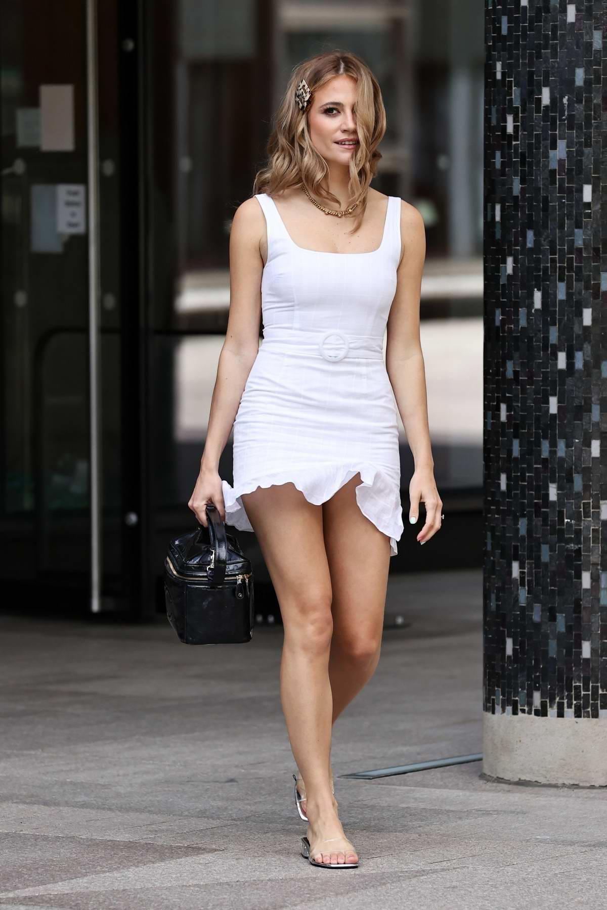 Pixie Lott looks stunning in a white mini dress as she leaves the Sunday Brunch TV show in London, UK