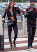 Rebecca Gormley is all smiles as she and Biggs Chris arrive at the Newcastle International Airport in Newcastle, UK