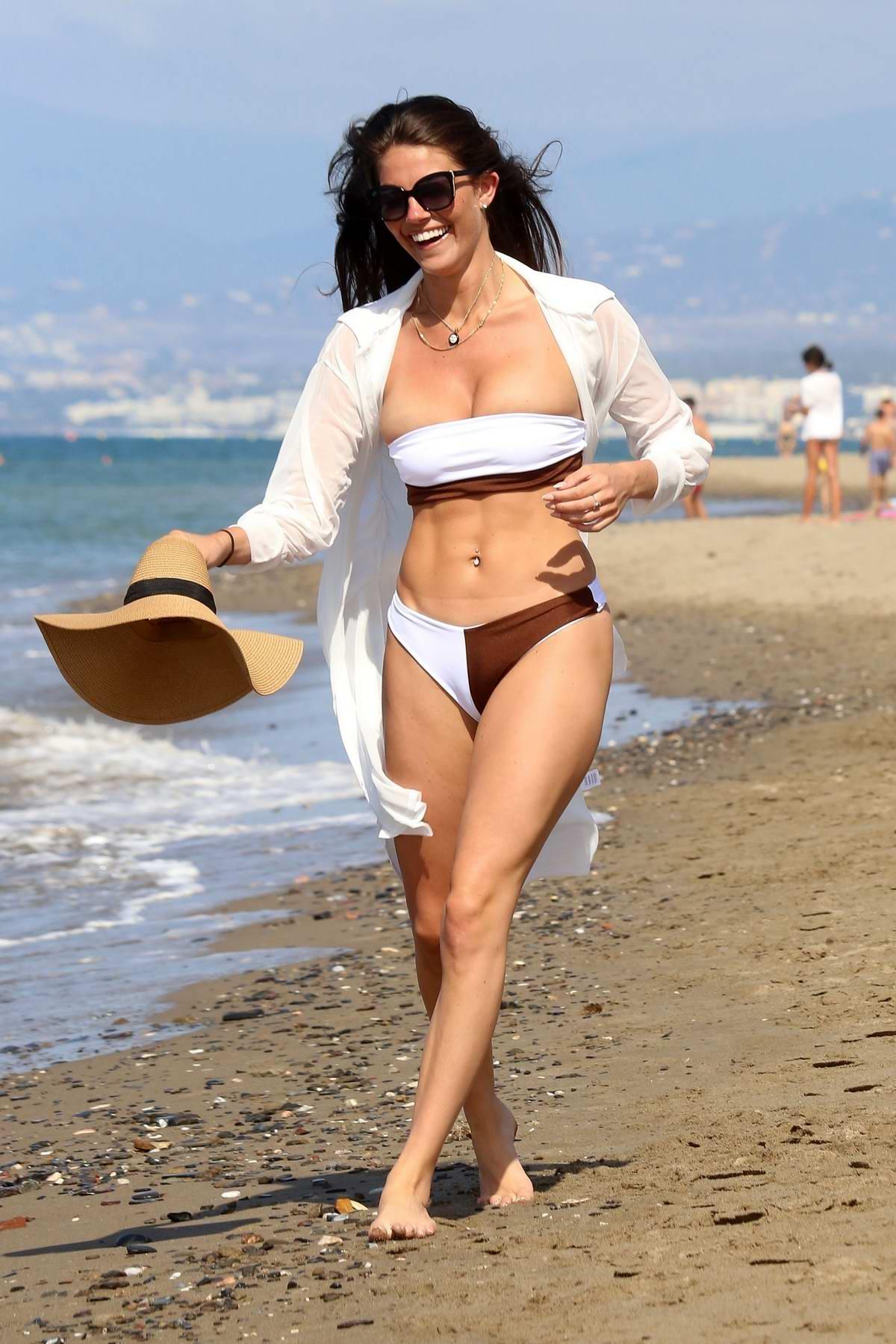 Rebecca Gormley looks fab a two-toned bikini while enjoying the beach with Biggs Chris in Marbella, Spain