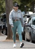 Rita Ora sports teal-green leggings and a hoodie while out for a walk in Notting Hill, London, UK