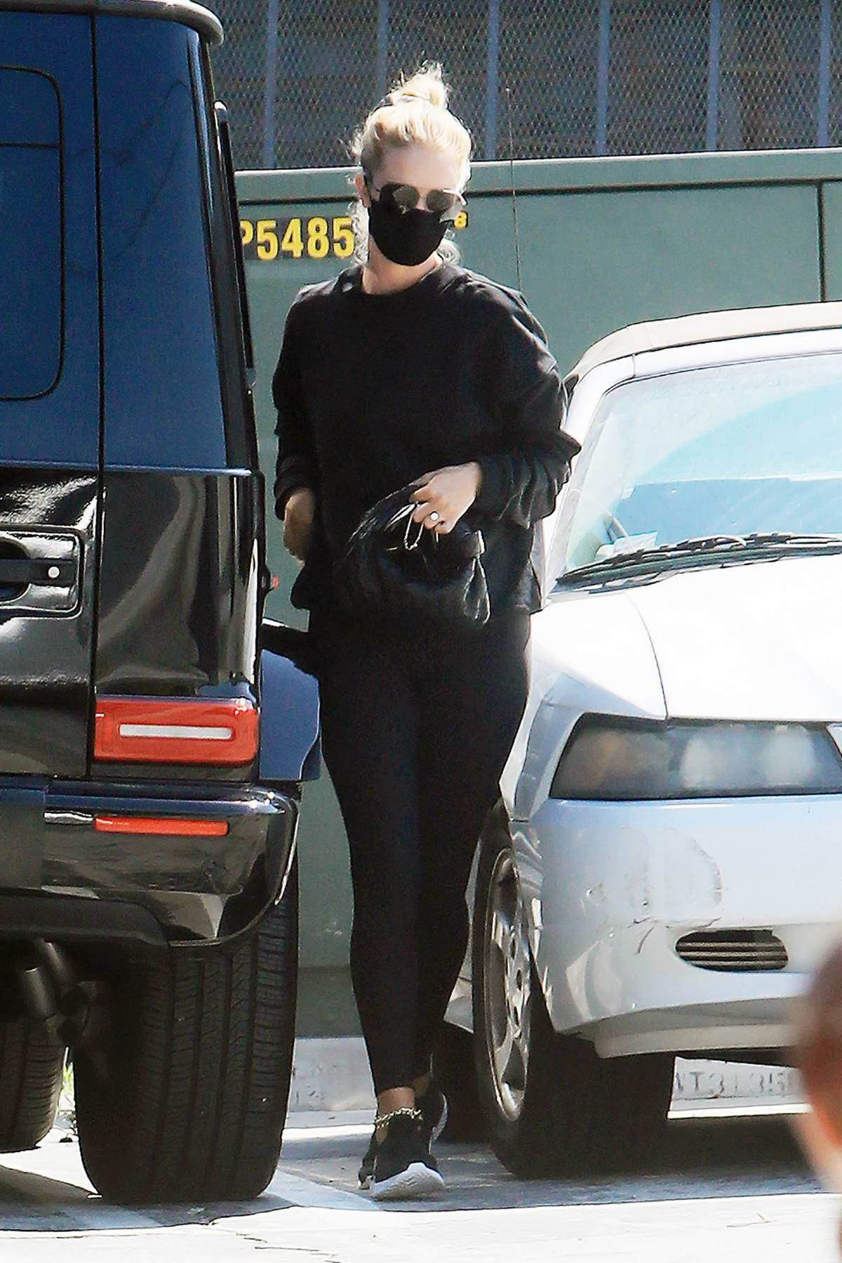Rosie Huntington-Whiteley flashes her large engagement ring as she heads to a gym in Los Angeles