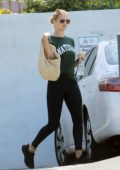 Rosie Huntington-Whiteley sports a green tee and black leggings as she heads to a gym in Los Angeles