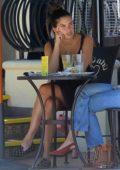 Sara Sampaio enjoys an Al Fresco lunch with a friend at Urth Caffe in West Hollywood, California