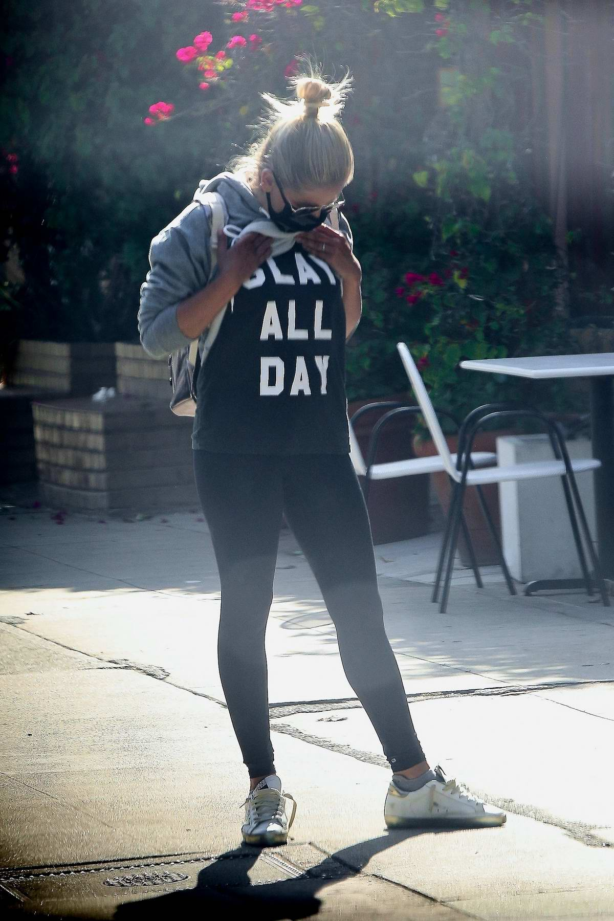 Sarah Michelle Gellar shows her 'Slay All Day' top to a friend while out for coffee in Los Angeles