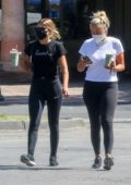 Sofia Richie sports a black tee and leggings during a juice run with a friend in Malibu, California
