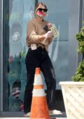 Sofia Richie wears a floral print mask as she stops for some cash at Chevron gas station in Malibu, California