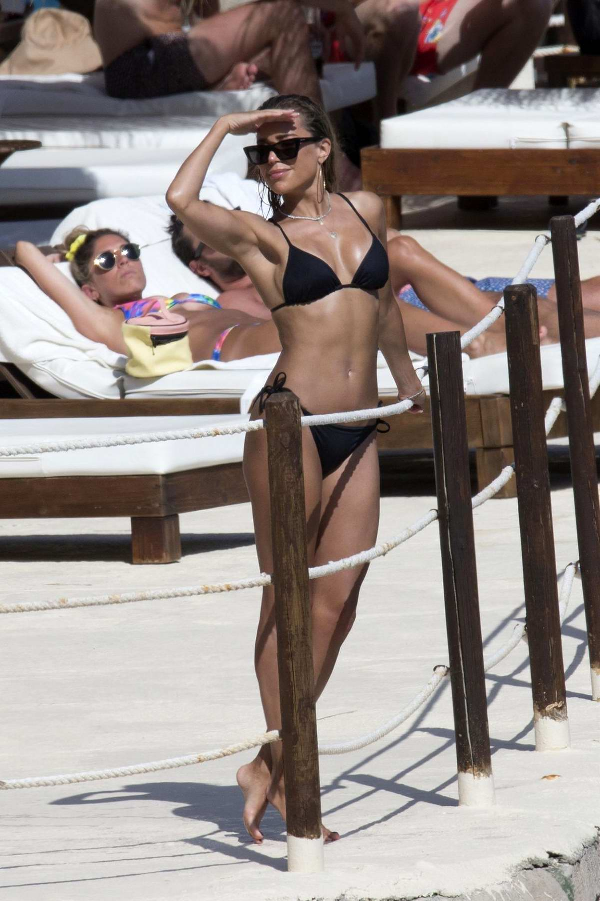 Sylvie Meis wears a black bikini as she enjoys a day at the beach in Mallorca, Spain