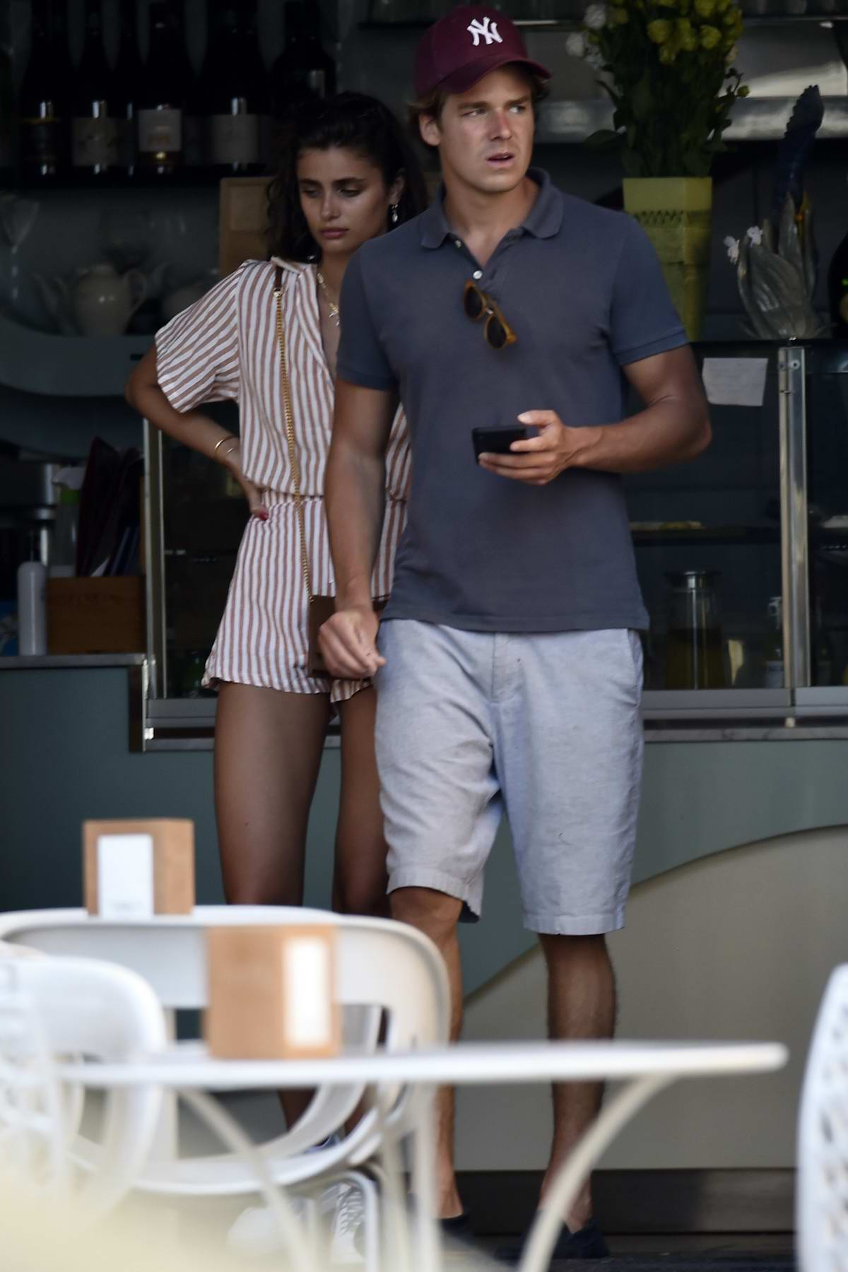 Taylor Hill steps out in a striped romper while on vacation with boyfriend Daniel Fryer in Portofino, Italy