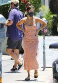 Vanessa Hudgens dons cute orange dress while out getting takeout and coffee in Los Angeles