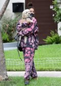 Vanessa Hudgens spotted in tie-dye sweatsuit while visiting a friend with her dog in Beverly Hills, California