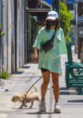 Vanessa Hudgens wears a green oversized tee while running errands with her dog in Los Feliz, California