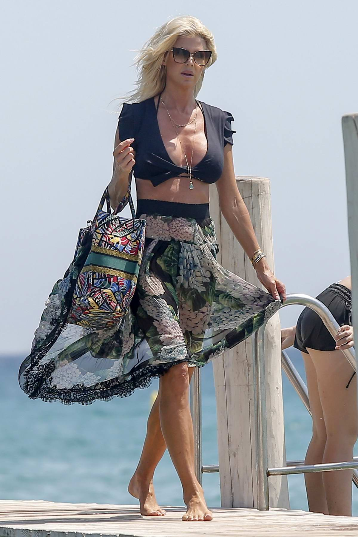 Victoria Silvstedt looks great floral print semi-sheer skirt as she arrives at club 55 in Saint-Tropez, France