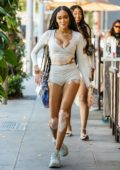 Winnie Harlow shows off long legs in tiny shorts paired with a matching crop top while enjoying some wine with friends at Il Pastaio in Beverly Hills, California