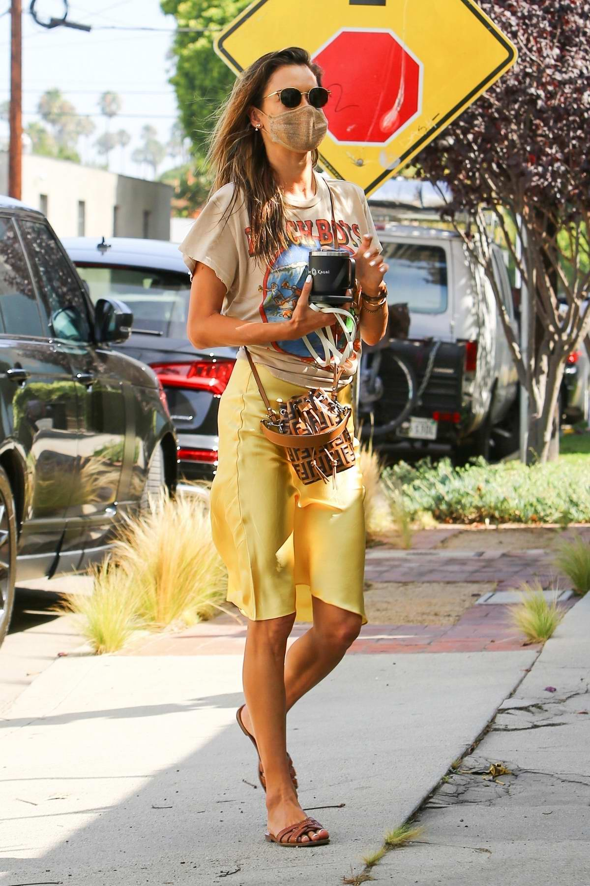 Alessandra Ambrosio dons a colorful ensemble while arriving at Slim Pictures Studio in Los Angeles, California