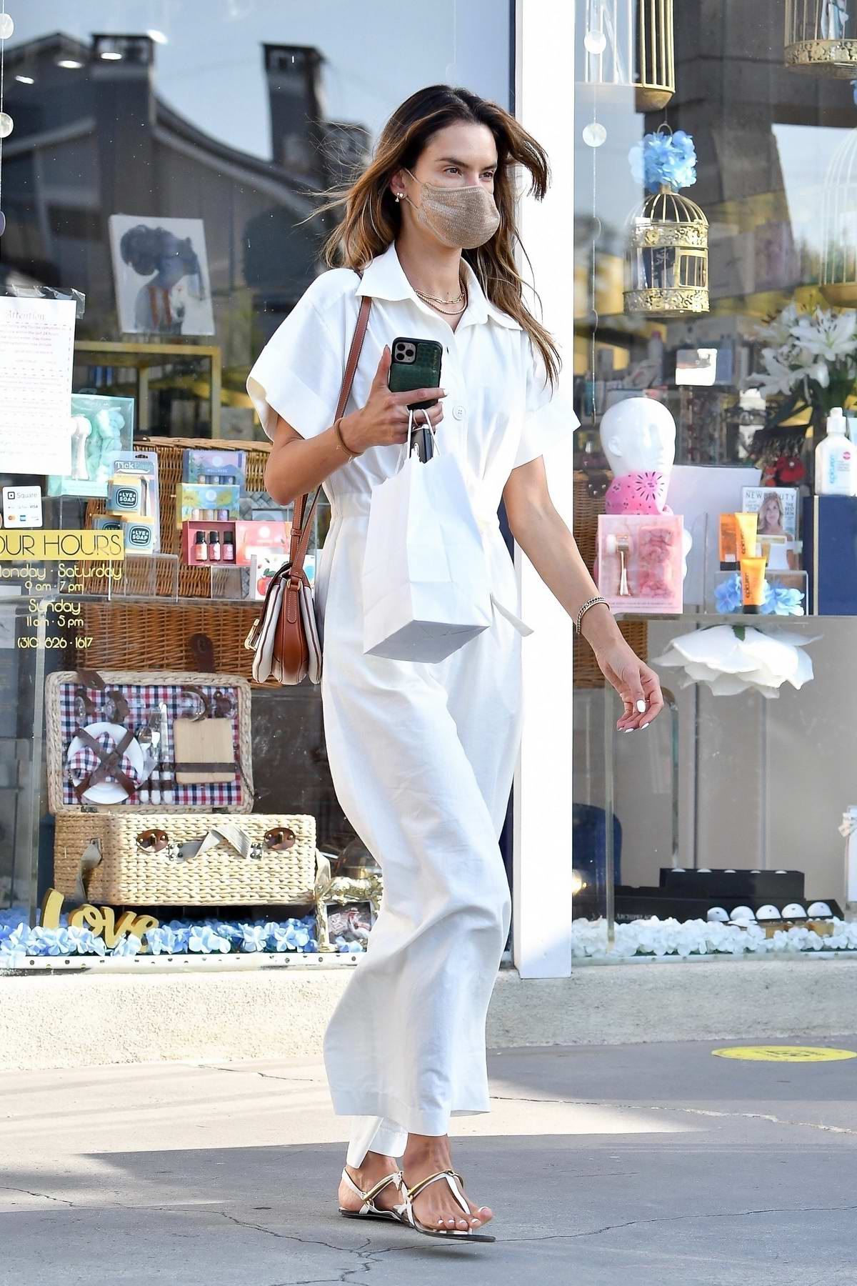 Alessandra Ambrosio looks great in a white jumpsuit as she steps out for some shopping before grabbing dinner to-go in Brentwood, California