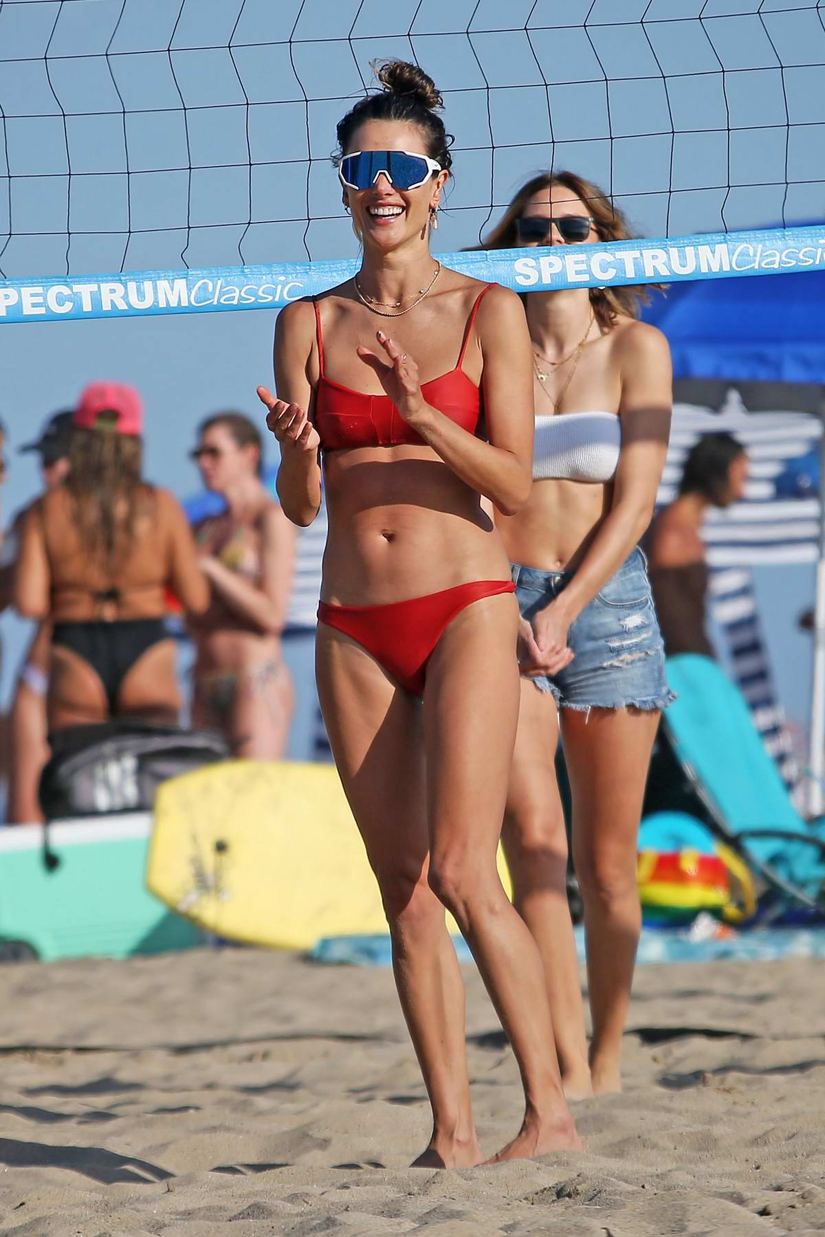 Alessandra Ambrosio looks incredible in a red bikini while playing some beach volleyball with friends in Malibu, California