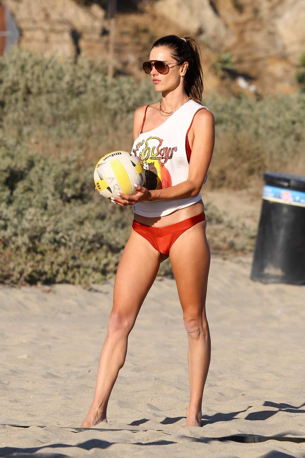 Alessandra Ambrosio looks stunning in a red bikini while out playing beach volleyball with friends in Malibu, California