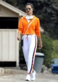 Alessandra Ambrosio sports a bright orange hoodie while out for a hike with a friend in Pacific Palisades, California