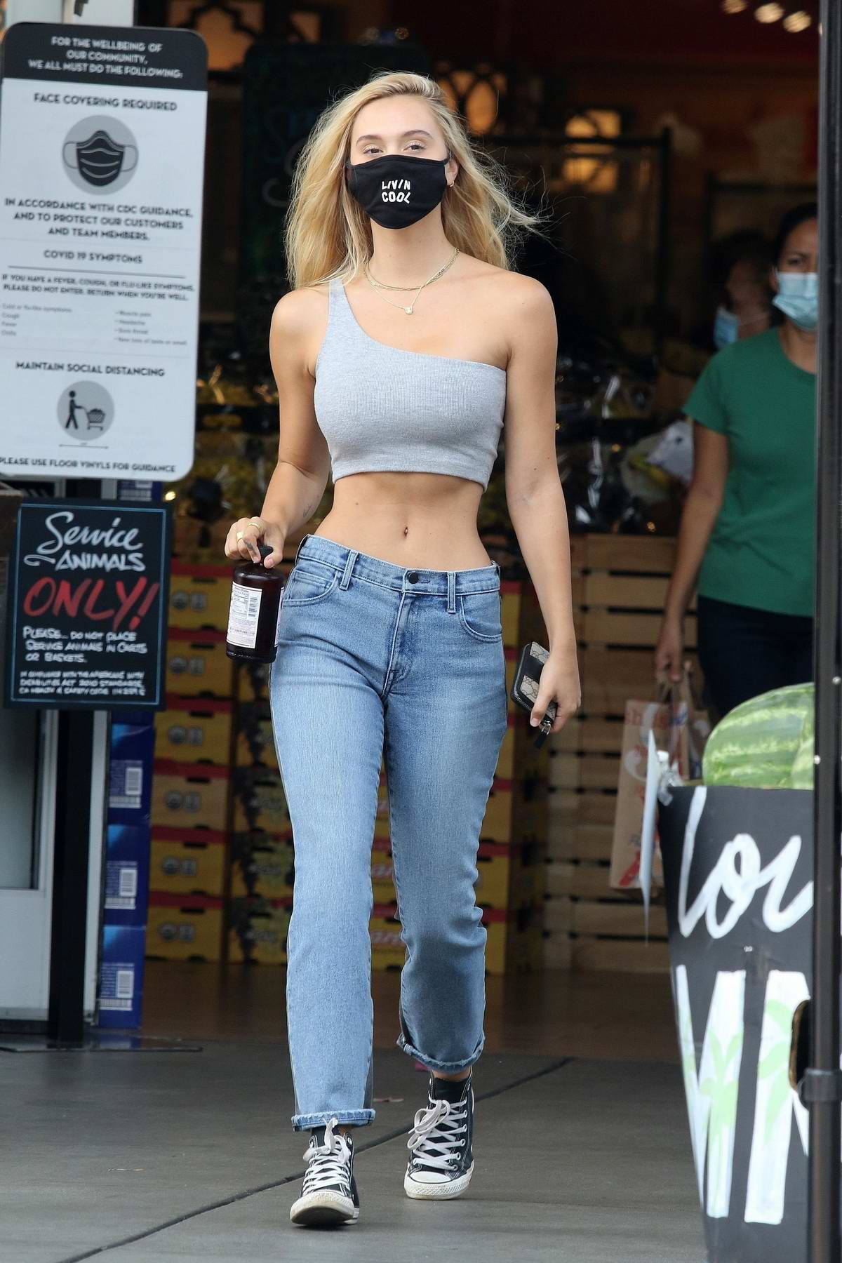Alexis Ren flaunts her toned midriff while making a stop for a Kombucha at Bristol Farms in Beverly Hills, California