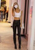Alexis Ren looks trendy in a white crop top and black leather pants as she heads to Catch LA in West Hollywood, California