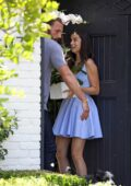 Ana de Armas looks pretty in a blue mini dress as she gets some flowers delivered in Brentwood, California