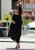 Angelina Jolie dons a black dress during a shopping trip with her son Knox in Los Feliz, California