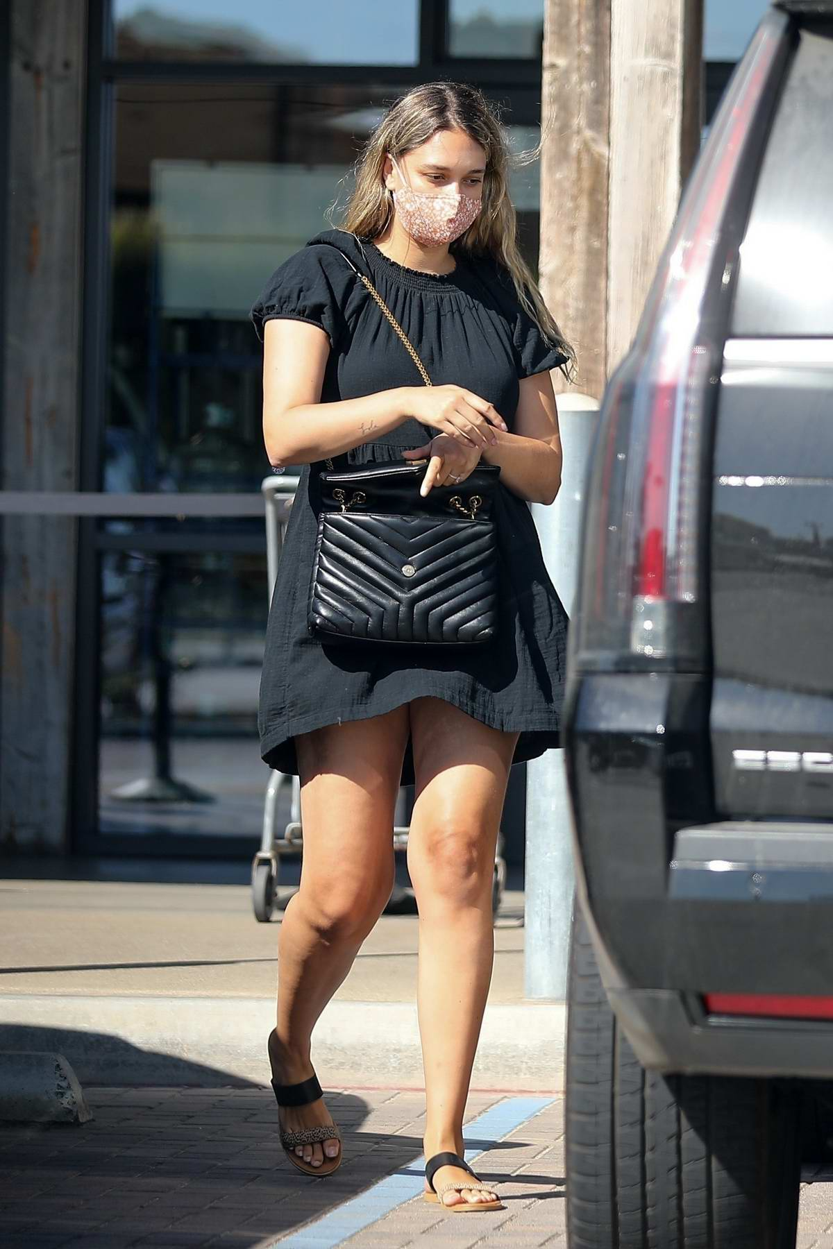 April Love Geary shops for groceries and picks up a couple of drinks from Starbucks in Malibu, California