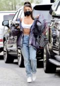 Ariana Grande keeps it trendy while arriving at a recording studio in Los Angeles