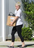 Ariel Winter wears a white tee and black leggings while offloading a few items from her car in Los Angeles