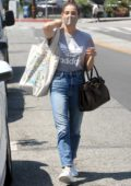 Ashley Greene wears an Adidas tee and jeans while running errands in West Hollywood, California