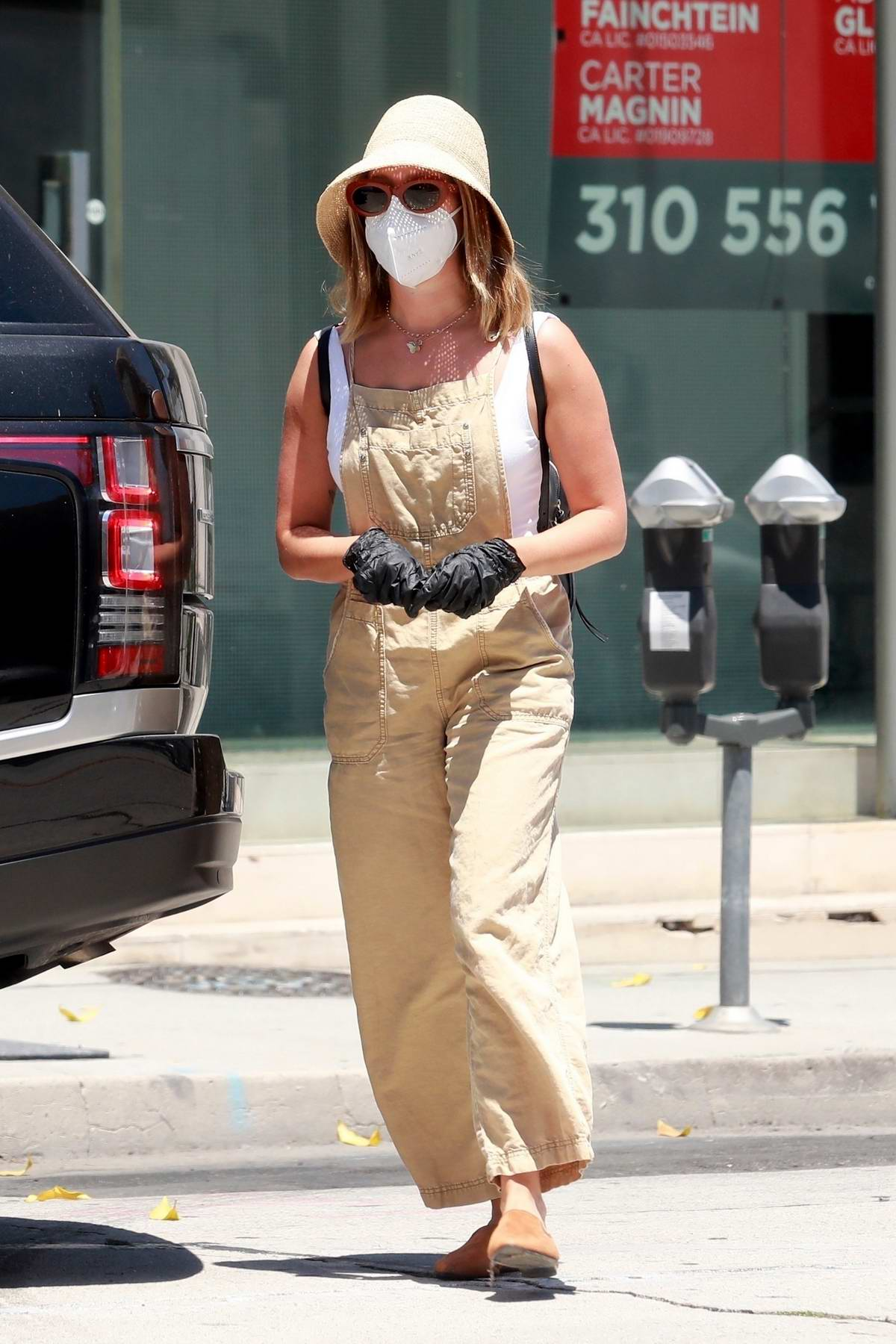 Ashley Tisdale wears face mask and gloves while stepping out for shopping in Los Angeles