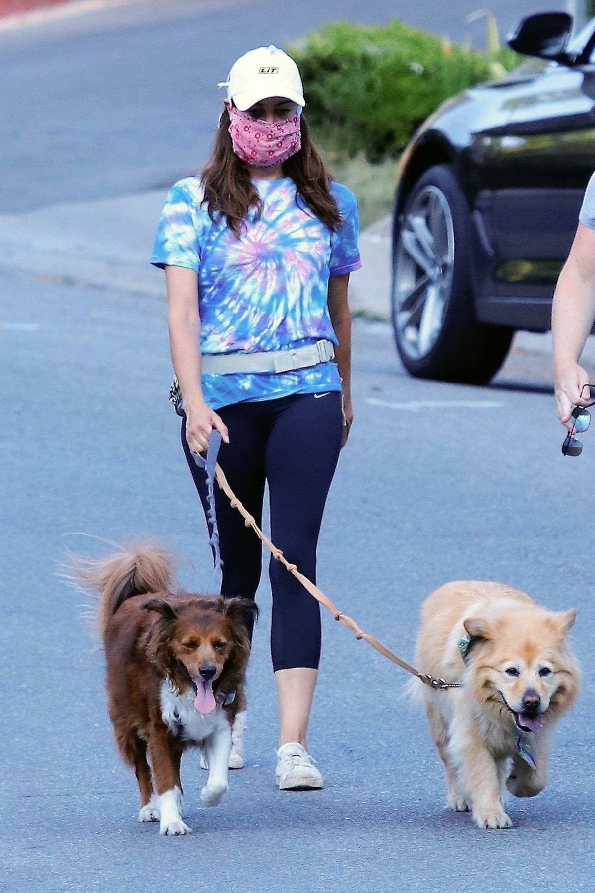 Aubrey Plaza wears tie-dye tee and black leggings as she takes her dogs out for a walk in Los Angeles