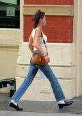 Bella Hadid keeps it casual as she returns home from a shopping trip in New York City