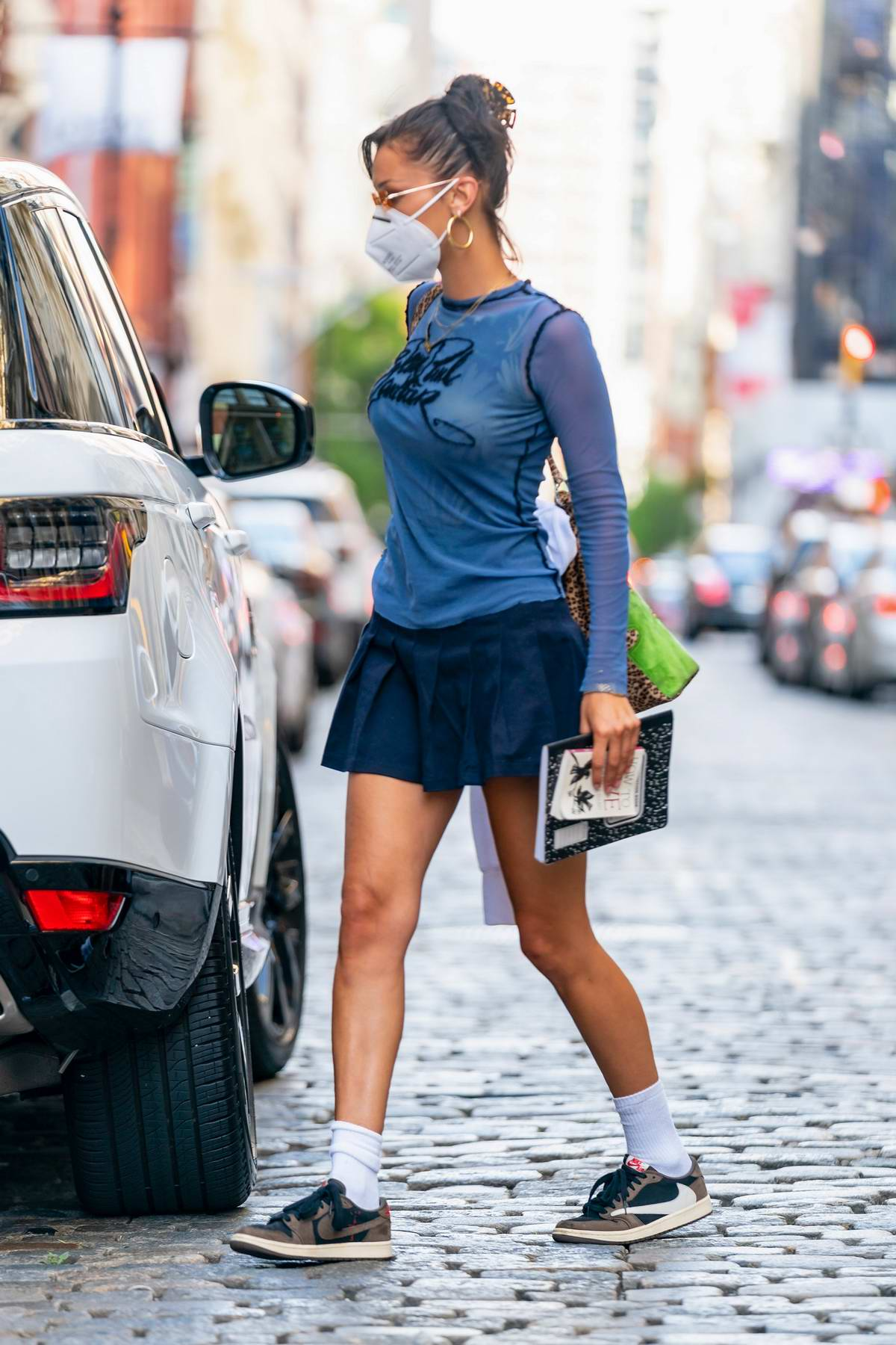 Bella Hadid looks stylish in Jean Paul Gaultier top and pleated mini skirt while heading out in New York City