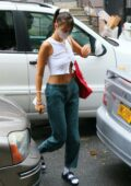 Bella Hadid shows off her toned midriff while visiting a friend in New York City