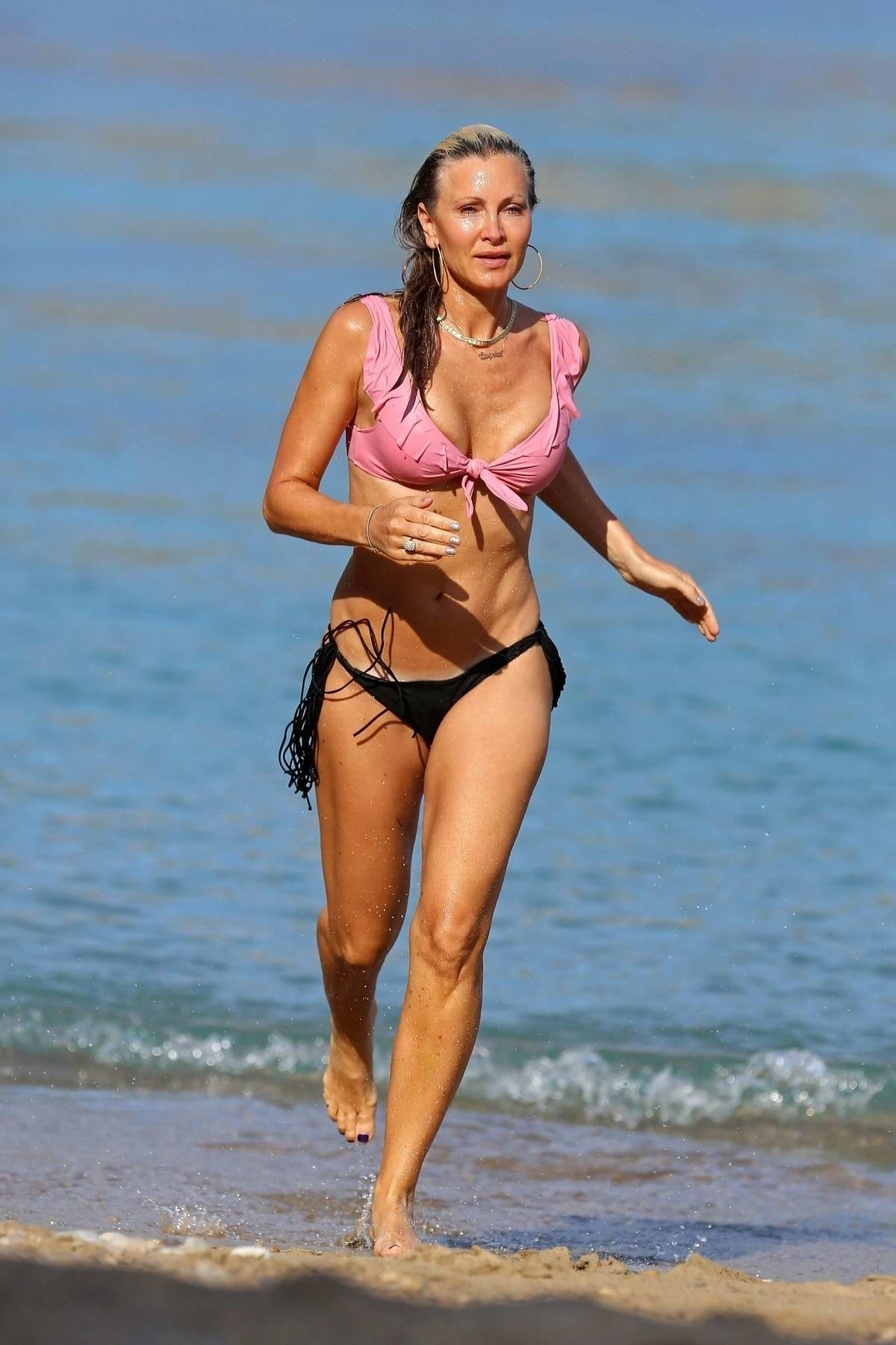 Caprice Bourret shows off her bikini body as she relaxes at the beach while on holiday in Ibiza, Spain