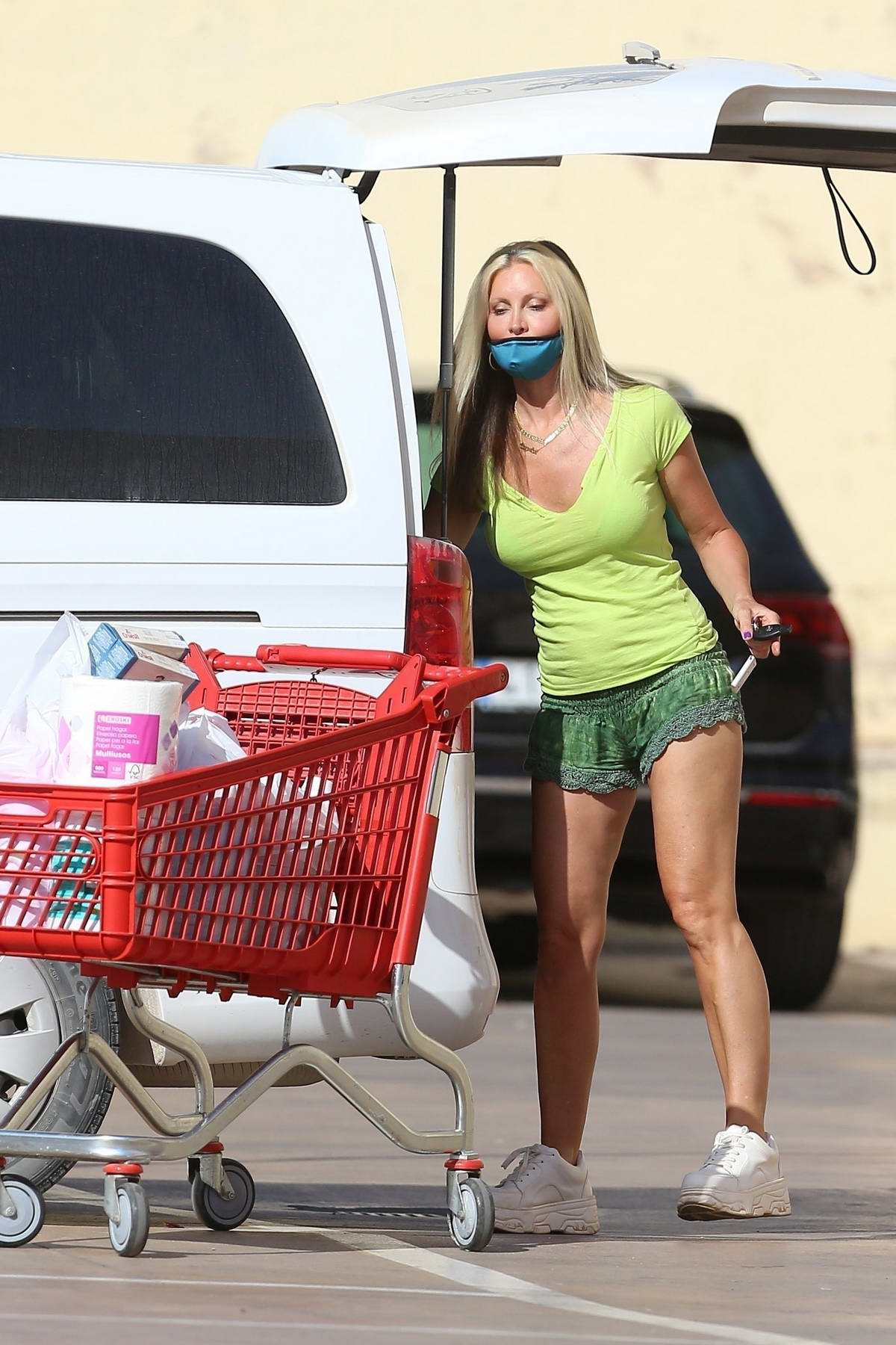 Caprice Bourret steps out in tiny shorts while picking up some groceries at a supermarket in Ibiza, Spain