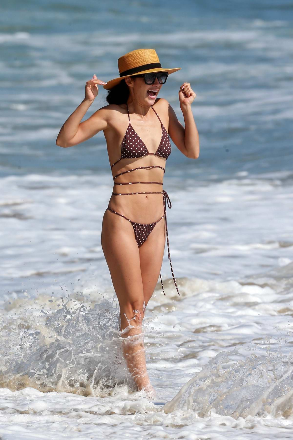 Cara Santana dons a polka dot bikini while enjoying a day at the beach with friends in Malibu, California
