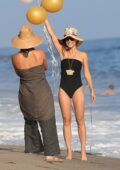 Cara Santana looks great in a black swimsuit while celebrating her birthday at the beach in Malibu, California