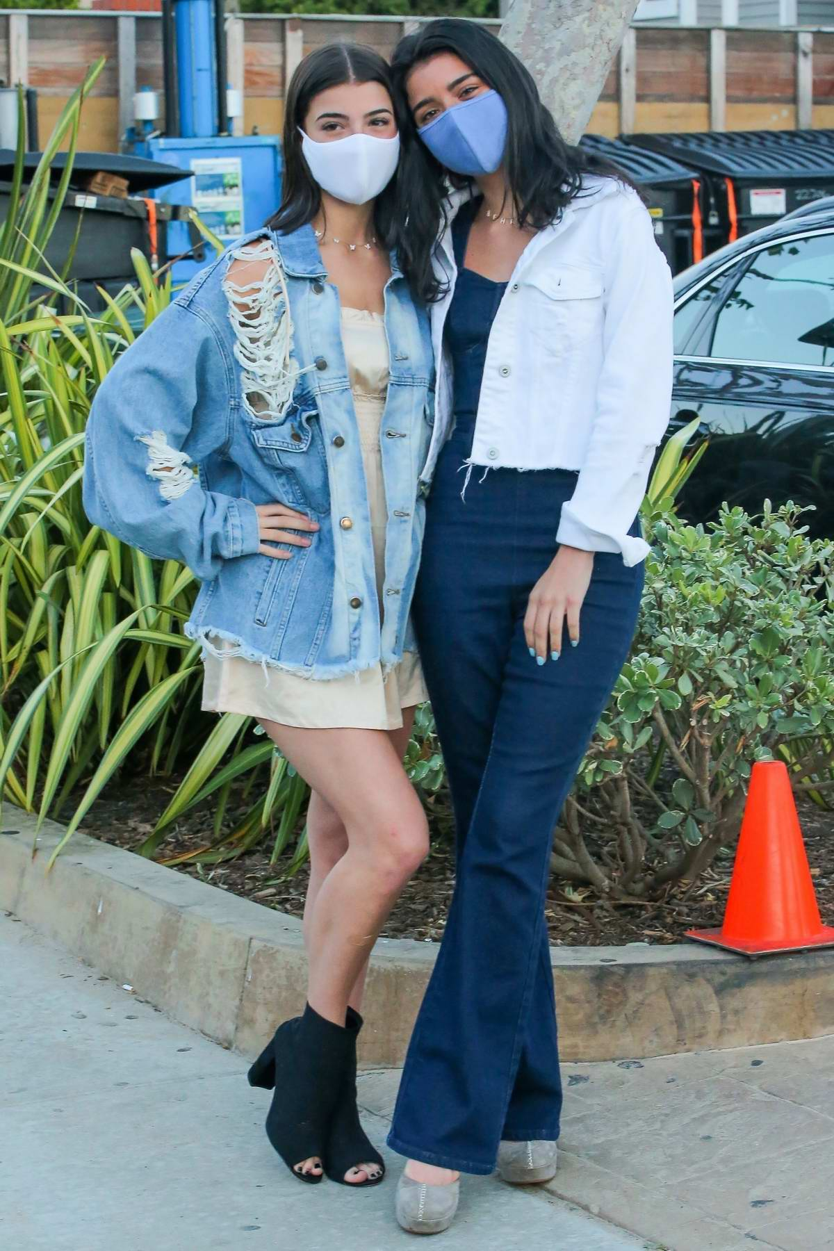 Charli D'Amelio and Dixie D'Amelio pose for photos after a family dinner at Nobu in Malibu, California