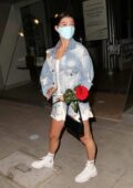 Charli D'Amelio seen carrying a red rose during a night out in Beverly Hills, California