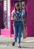 Daisy Edgar-Jones seen wearing mask while grabbing coffee in London, UK