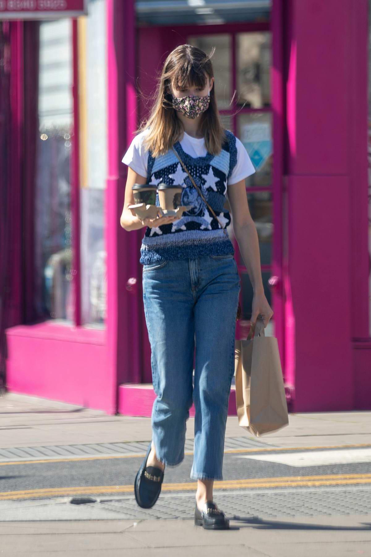 Daisy Edgar-Jones seen wearing mask while grabbing coffee in London, UK