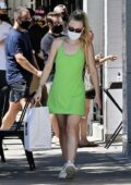 Dakota Fanning wears a short green dress to pick up her food-to-go at Joan's on Third in Studio City, California