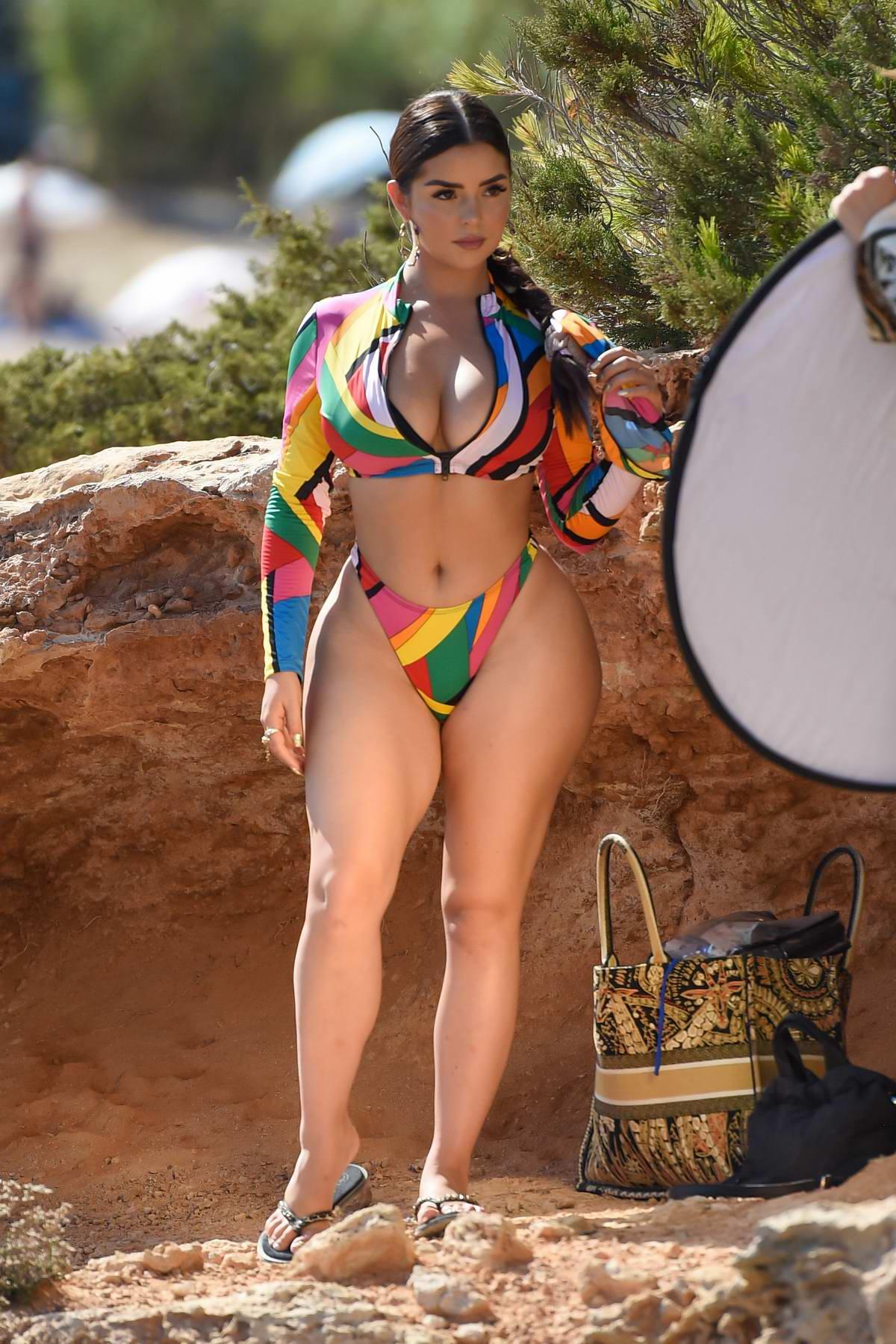 Demi Rose stuns in a colorful bikini while posing for a beach photoshoot in Ibiza, Spain