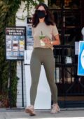 Eiza Gonzalez sports a beige top and green leggings while grabbing an iced Macha at Alfred's in Studio City, California