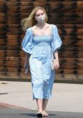 Elle Fanning looks pretty in blue summer dress as she stops by a florist shop with her mom in Los Angeles