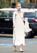 Elle Fanning radiates in a white dress paired with a personalized mask while out shopping in Los Angeles